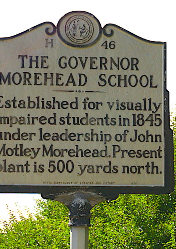 photo of governor Moorhead school sign on post